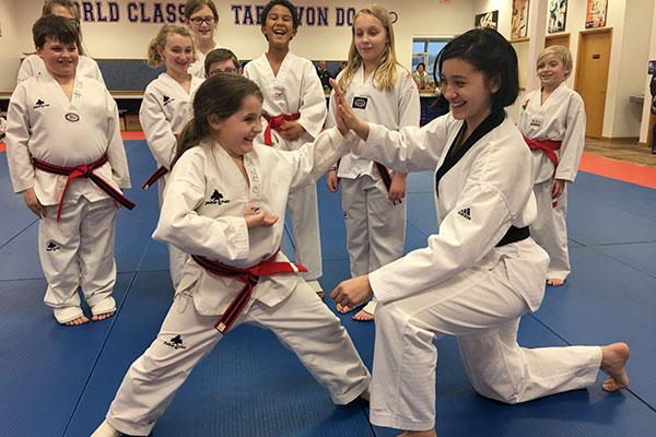 mom and daughter taekwondo